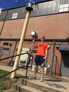 Paul stands at the NHS bell ready for victory. (PHOTO, Wiles)